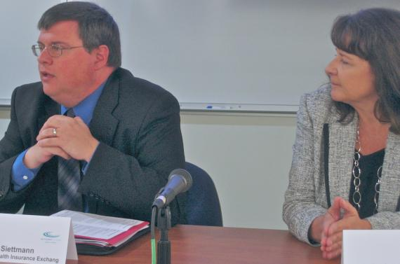 Andrea Routh listens to Mark Siettman make a point about Proposition E