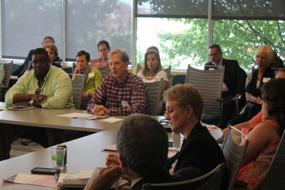 Psychologist George Harris (center) addressed a question to a Missouri Department of Mental Health consultant at a meeting in Kansas City