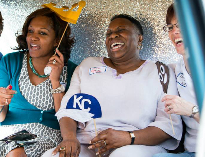Brenda Calvin, Rhonda Holman and Bridget McCandless in the photo booth at HCF's 10-year celebration picnic last year.