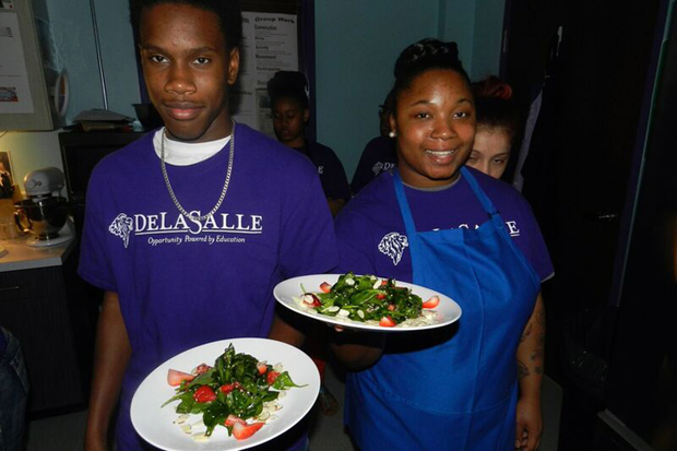 Students at DeLaSalle Education Center serve up some healthy and delicious spinach salads.