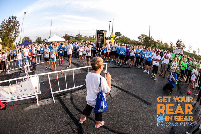 One survivor of colon cancer speaks to the crowd of runners at Get Your Rear in Gear in 2015.