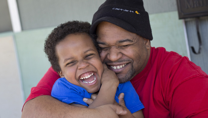 Carlos and Kaden receive individualized services and therapies from Operation Breakthrough, resulting in a healthy relationship that suits them to a T. Photo credit: Gloria Baker Feinstein
